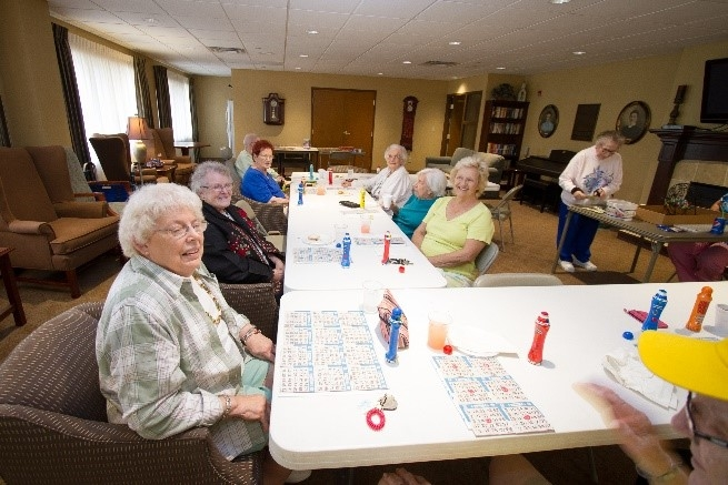 Welty apartment residents enjoying a game of bingo together.