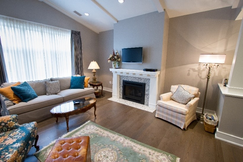 A Welty TownHome living room, complete with a fireplace and seating arrangements.