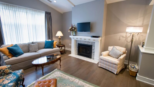 A view of a Welty Townhome living room — complete with fireplace and vaulted ceilings.