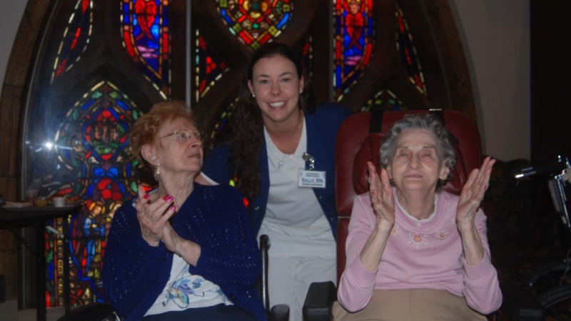 Carol Hartong, Nurse Sally Danhart, and Ernestine Owens enjoy music on speakers in one of Good Shepherd's day rooms.