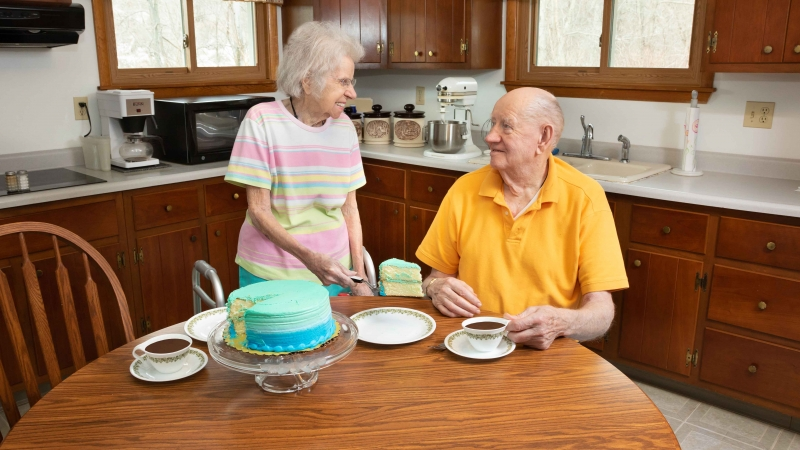 Couple enjoying coffee and cake